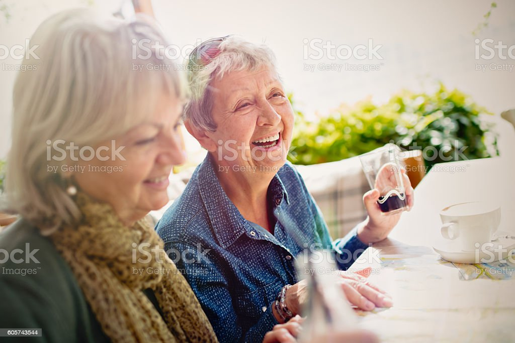 Two ladies in sidewalk cafe stock photo