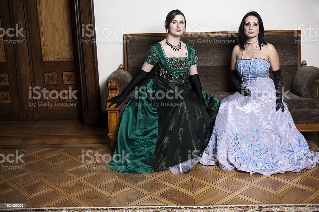 Two ladies on couch royalty-free stock photo