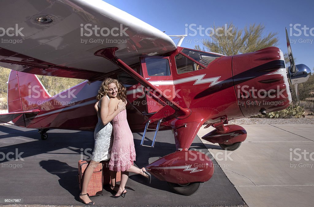 Two ladies saying goodbye royalty-free stock photo