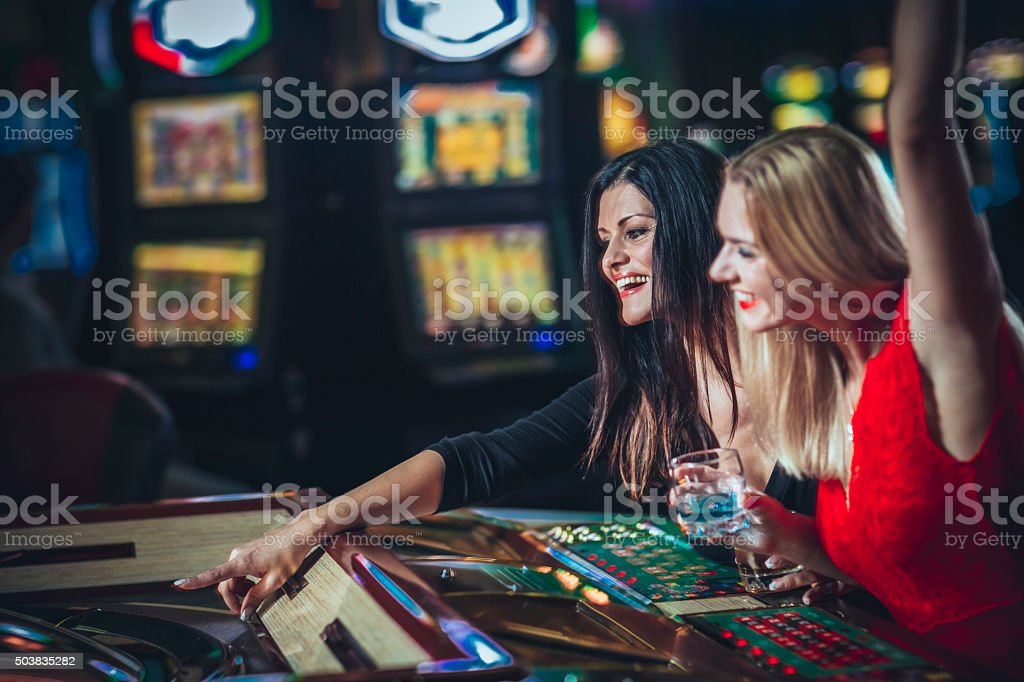 Two  lady's  gambling at the casino stock photo