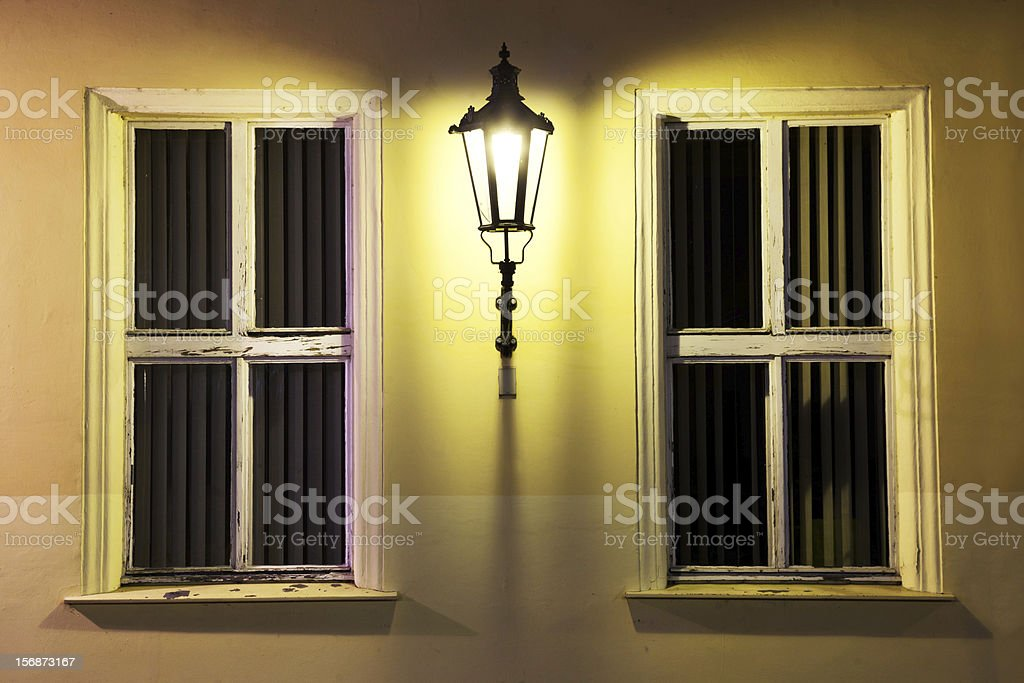 Two Lamplit Windows at Night royalty-free stock photo