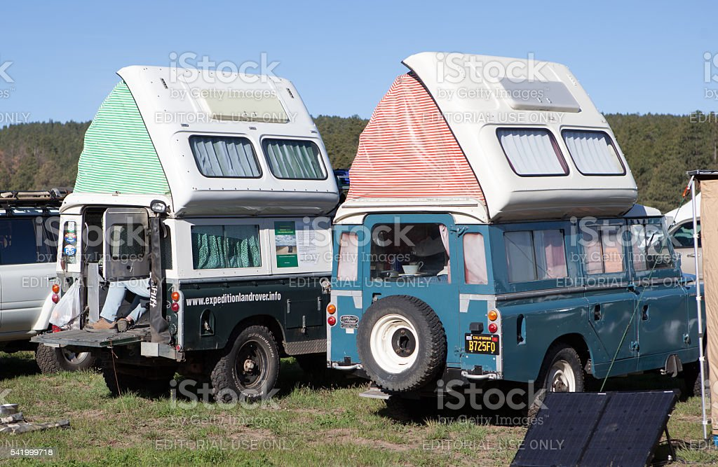 Two Landrovers with pop top tents at Overland Expo stock photo