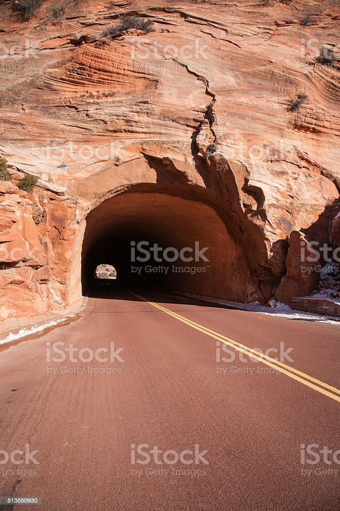 Two Lane Highway carved into Mountain Tunnel stock photo