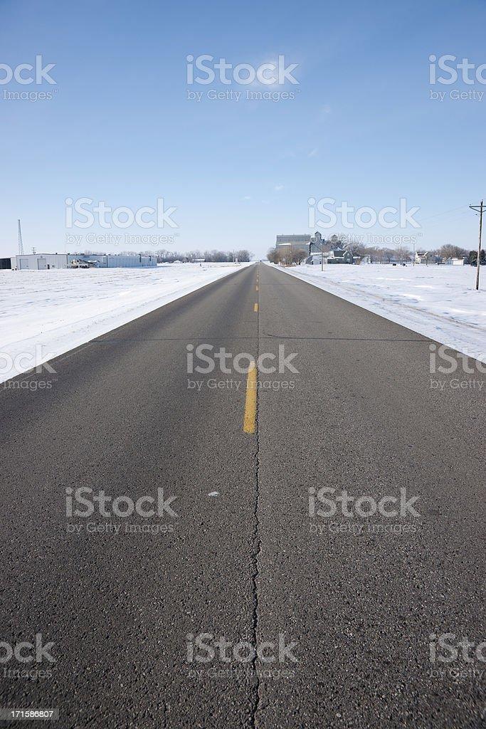 Two Lane Highway Passing through Remote Rural Town royalty-free stock photo