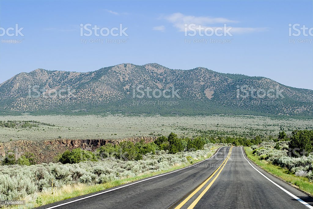 Two Lane Road Flat High Desert Toward Mountains New Mexico royalty-free stock photo