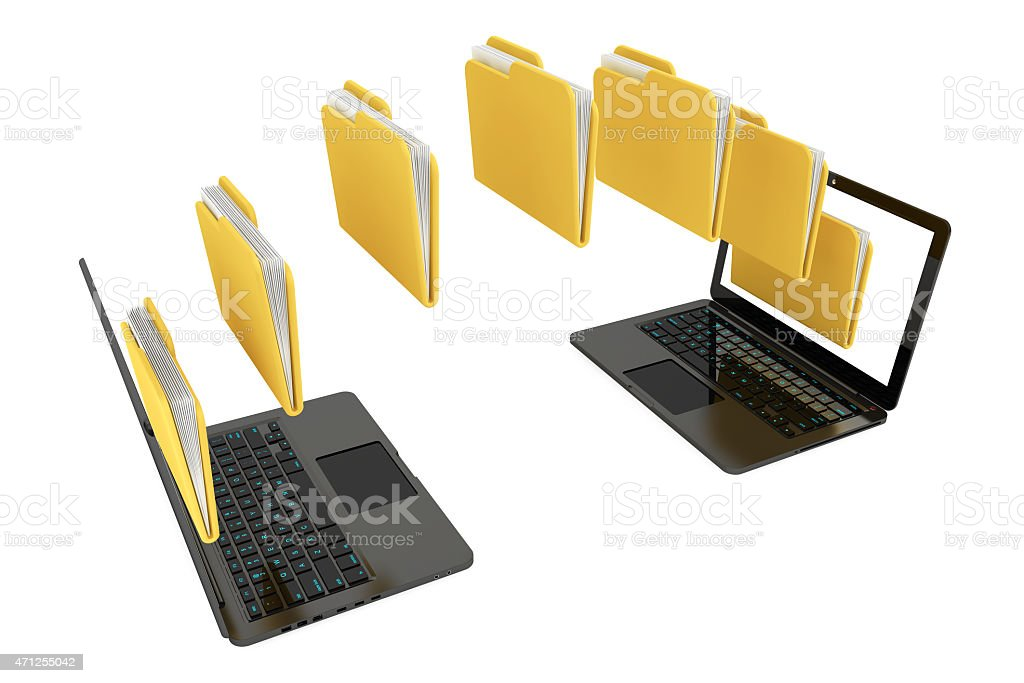 Two laptops with folders moving from one laptop to the next stock photo