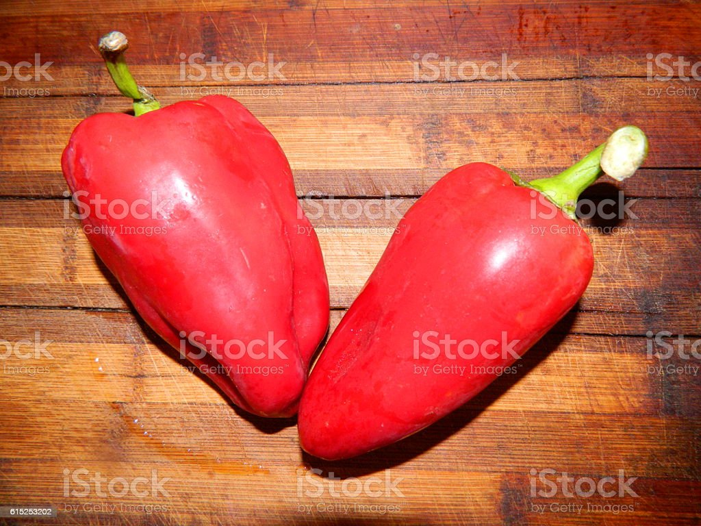 Two large red sweet pepper stock photo