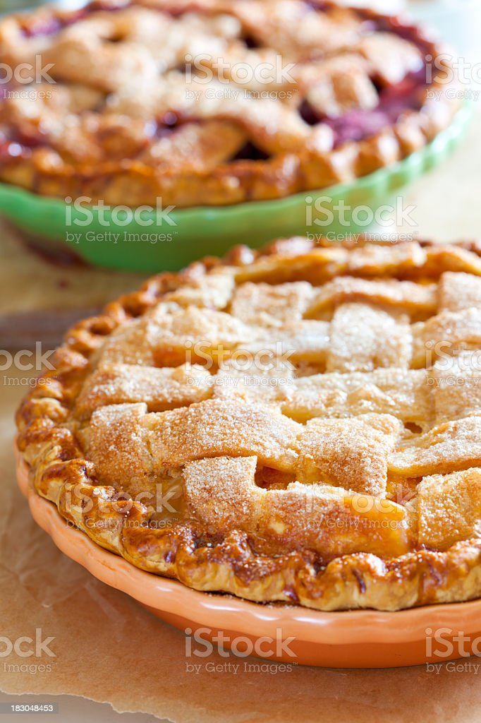 Two lattice topped pies in dishes stock photo