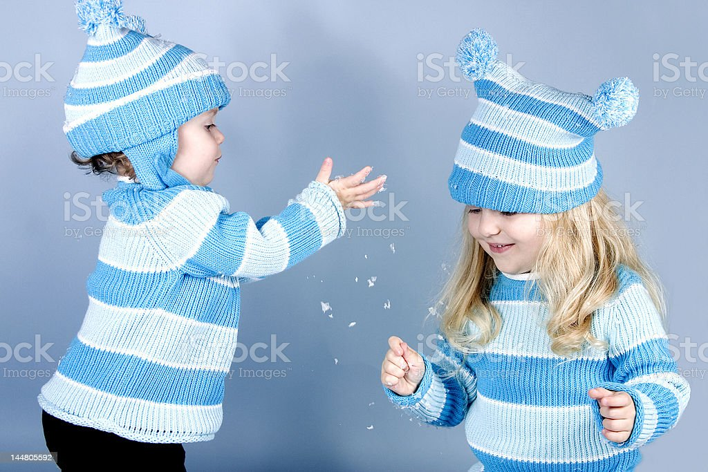 Two laughing girls in snow royalty-free stock photo