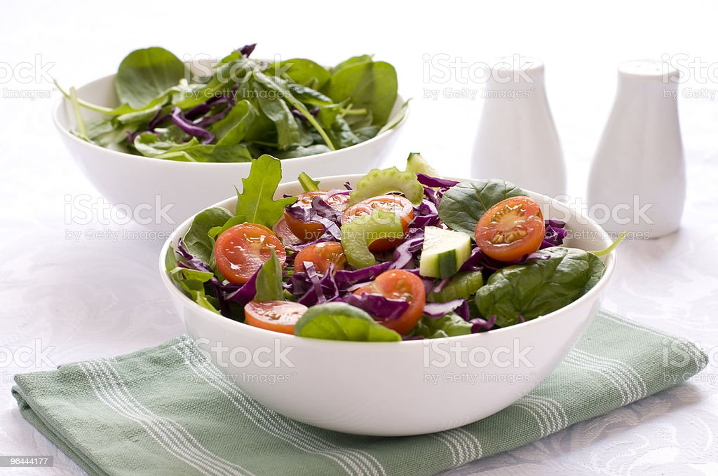 Two Leafy Green Salads in a bowl stock photo