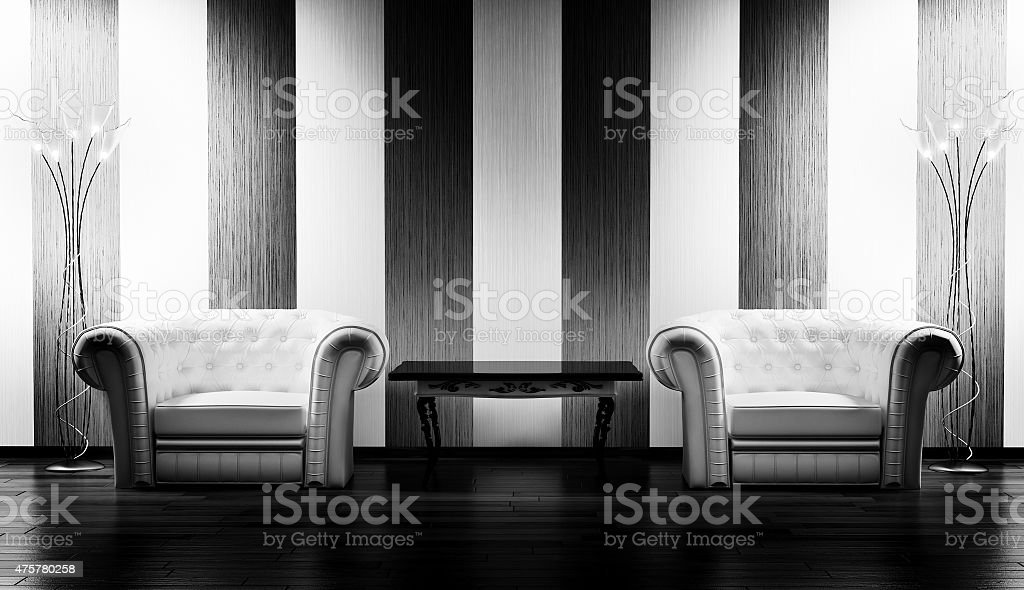 Two leather armchairs,table and floor lamps stock photo