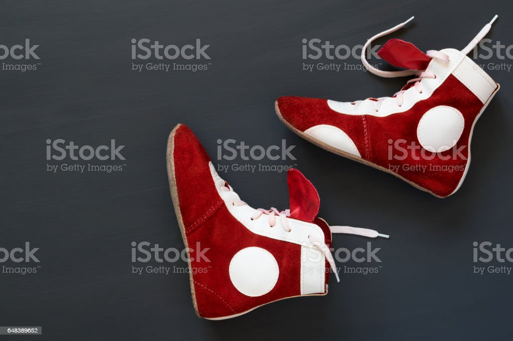 two leather boots to fight on a black background stock photo