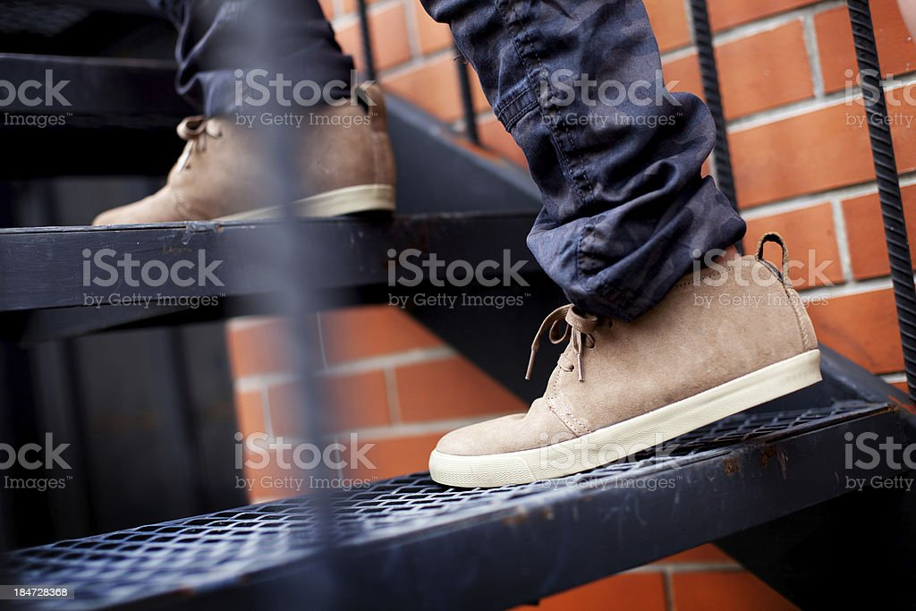 Two legs up the stairs royalty-free stock photo