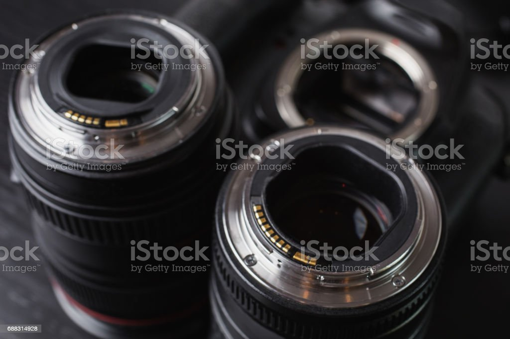 Two lenses and a camera mount. Contacts of the microprocessor on the lens for connection to the camera. stock photo