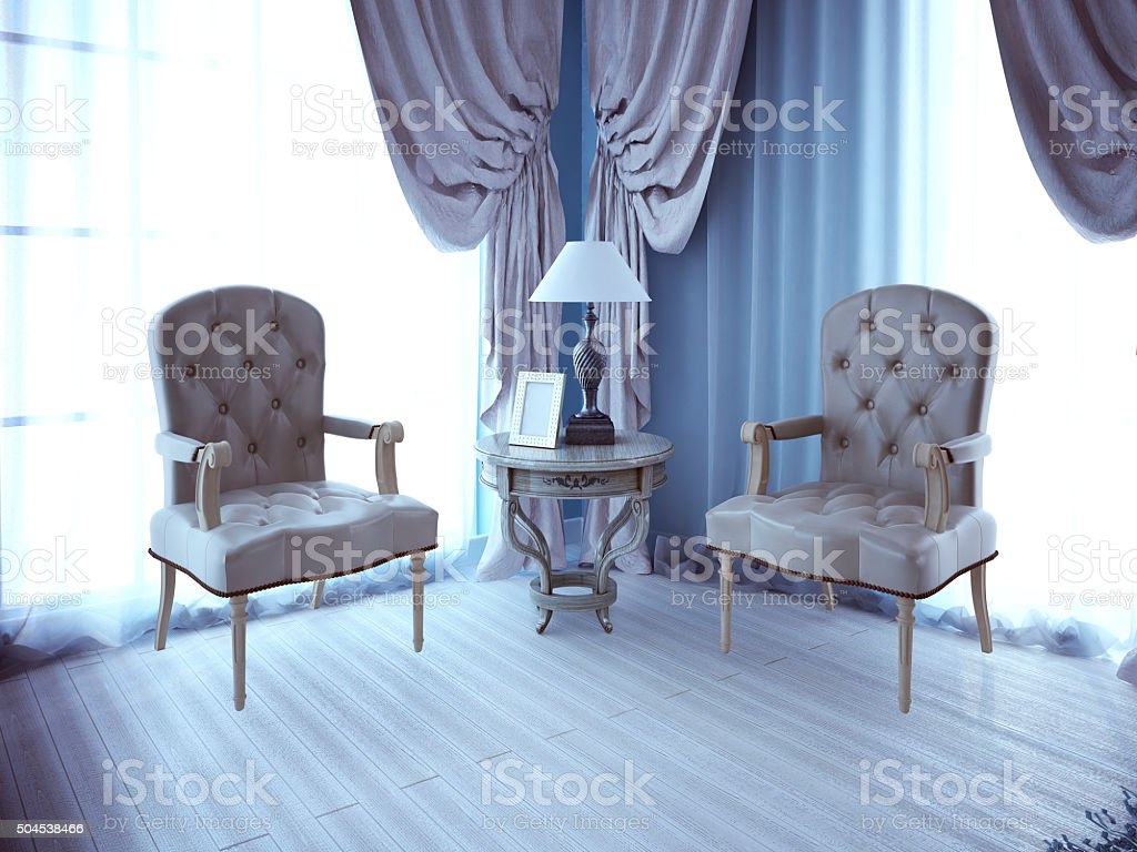 Two lether unpolstery armchair near window stock photo