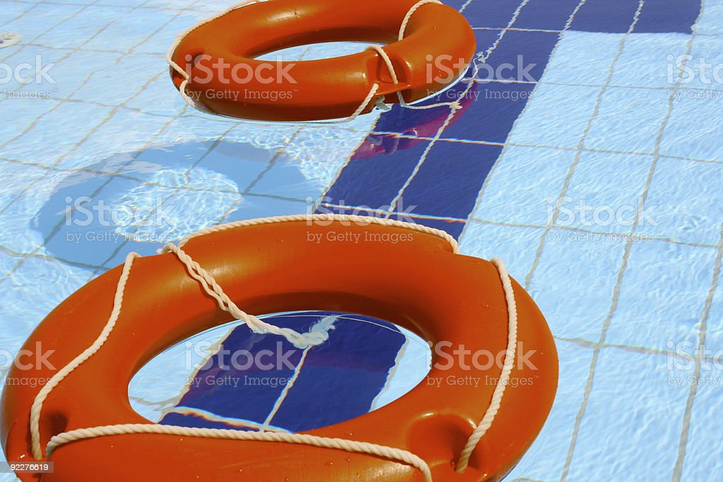 Two Lifebuoy in swimming pool - Close-up royalty-free stock photo