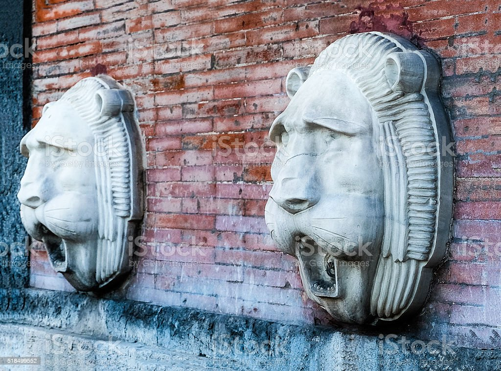 Two lion-head fountains stock photo