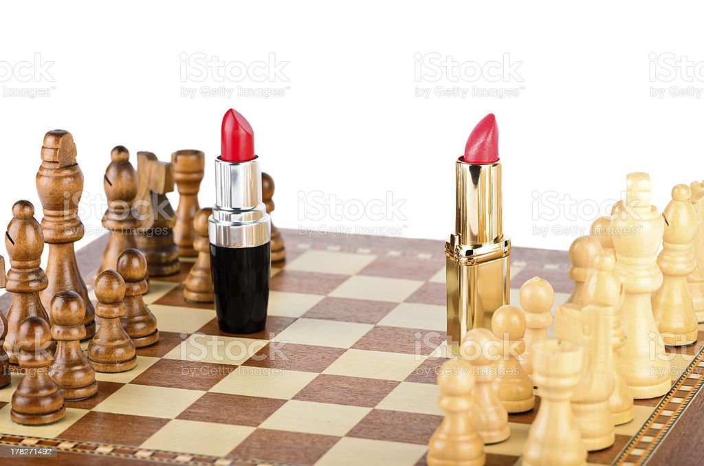 Two lipsticks on the battlefield of chess royalty-free stock photo