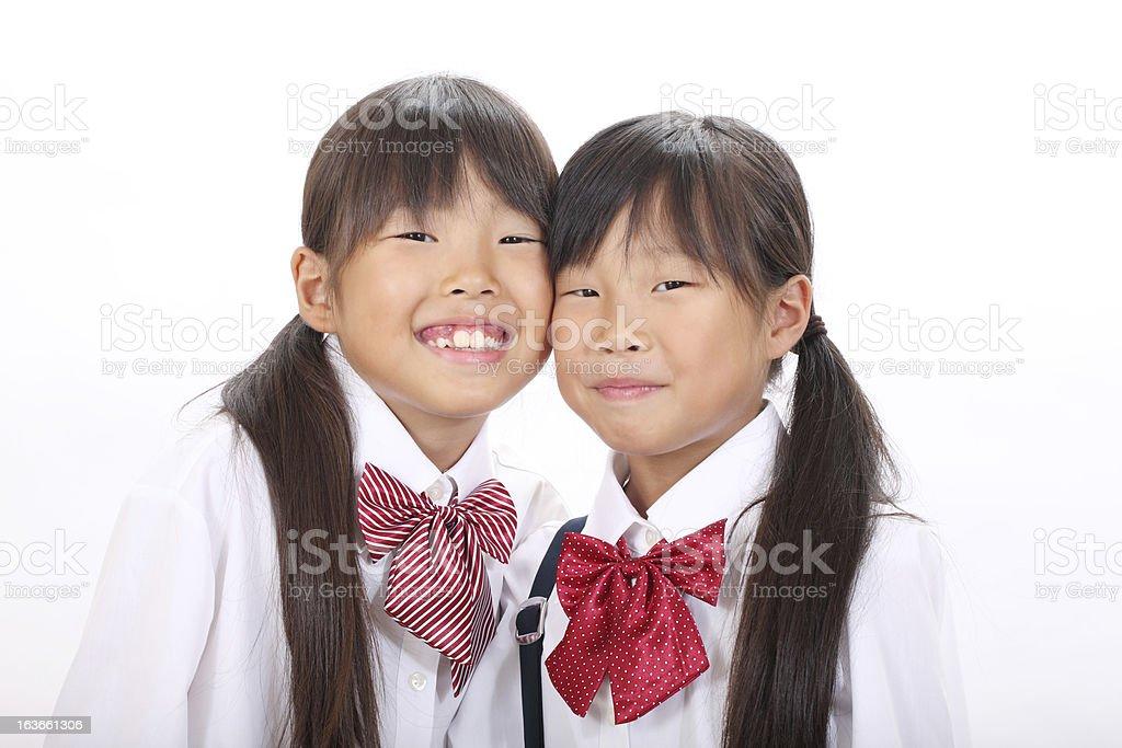 Two little asian schoolgirls royalty-free stock photo