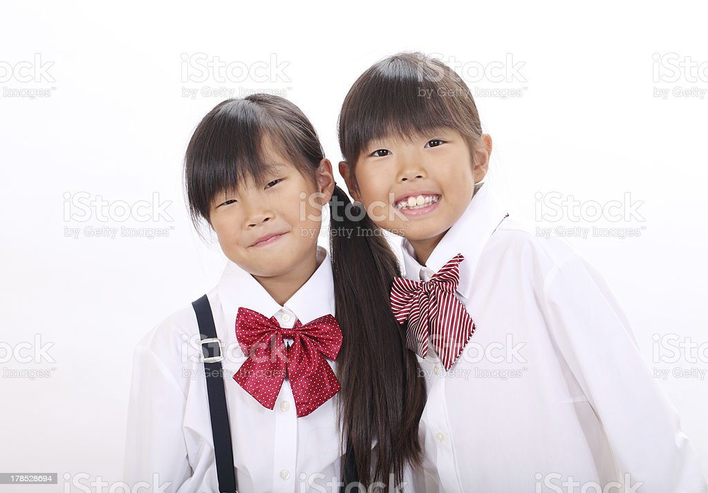 Two little asian schoolgirls royalty-free stock photo