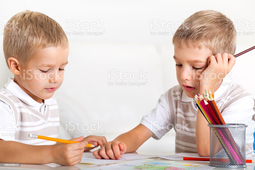 Two little boys drawing stock photo