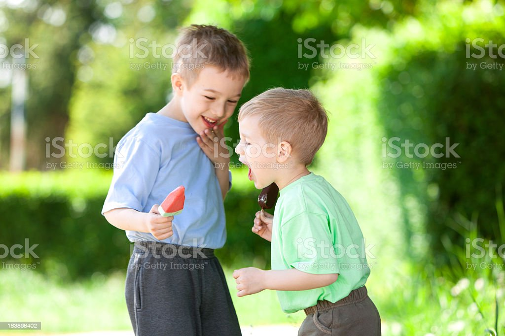 Two little boys eating ice cream royalty-free stock photo
