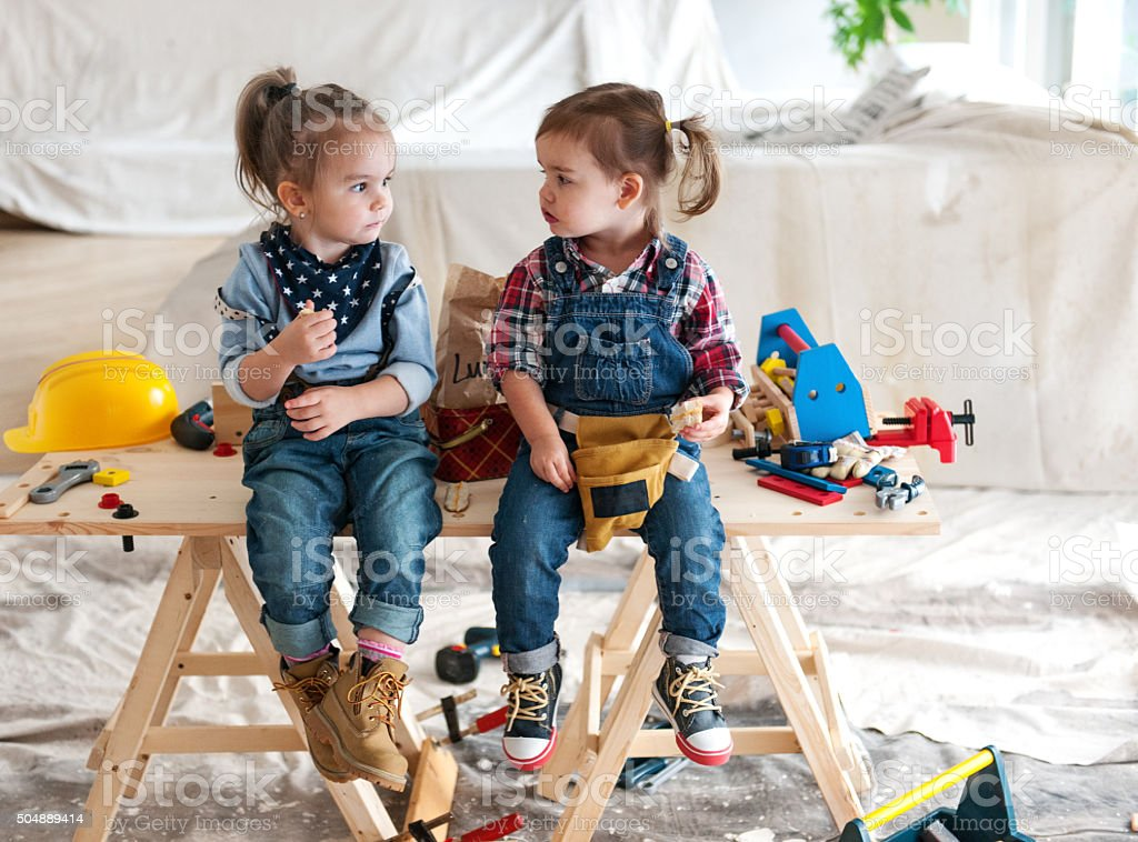 Two little Carpenters stock photo