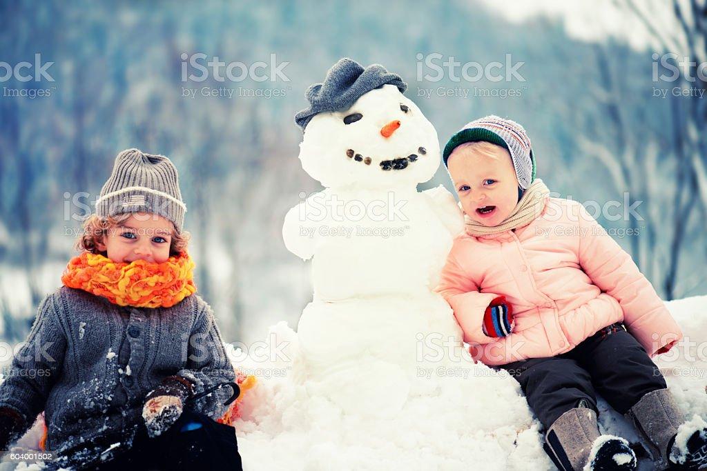 Two Little Children Enjoying Winter stock photo