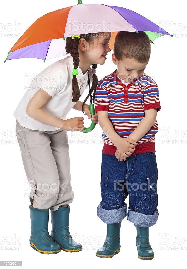 Two little children under umbrella stock photo