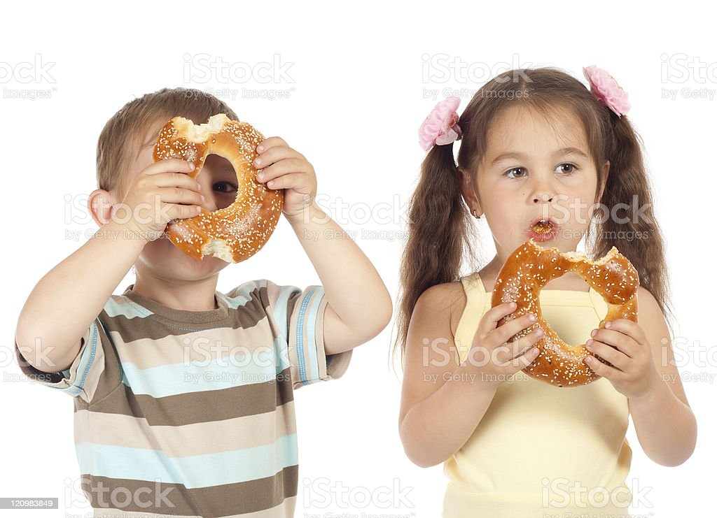 Two little children with bagels royalty-free stock photo