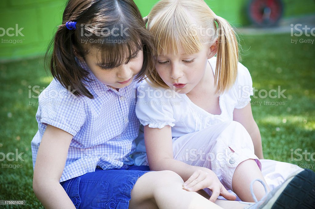 Two little friends playing doctors and nurses royalty-free stock photo