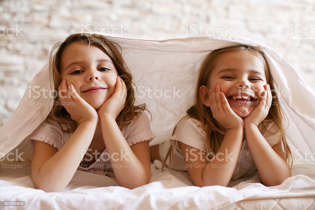 Two little girl in bed. stock photo