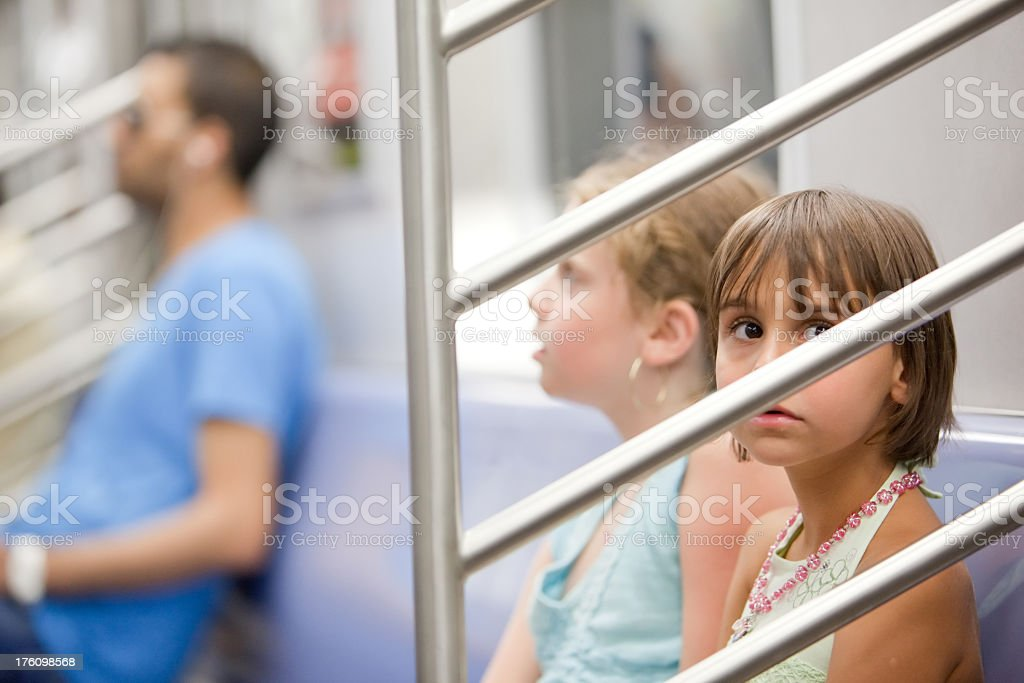 Two little girl in the subway car royalty-free stock photo