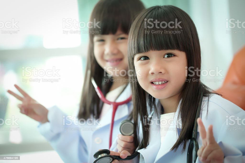Two little girl kid doctor dressed stock photo