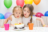Two little girls at a birthday party