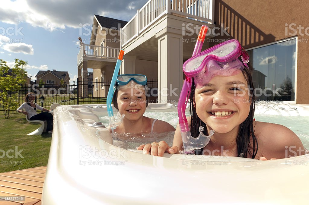 Two little girls have fun in small swimming pool royalty-free stock photo