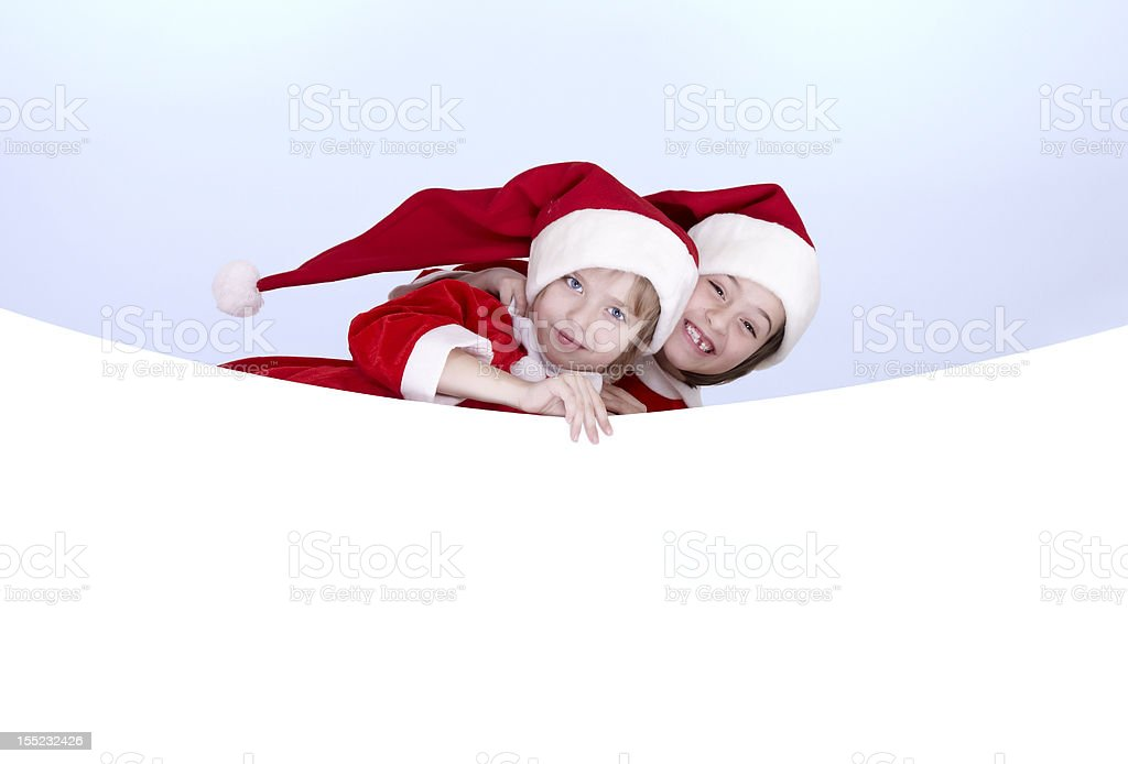 Two little girls holding a banner royalty-free stock photo