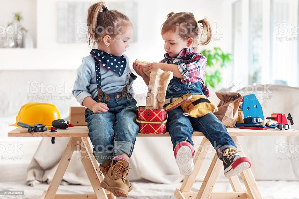 Two Little Girls sharing Lunch stock photo
