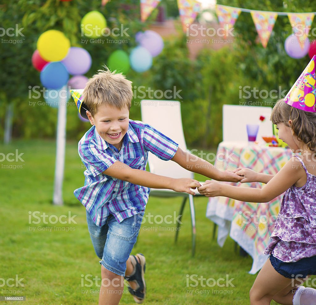 Two little kids dancing roundelay royalty-free stock photo