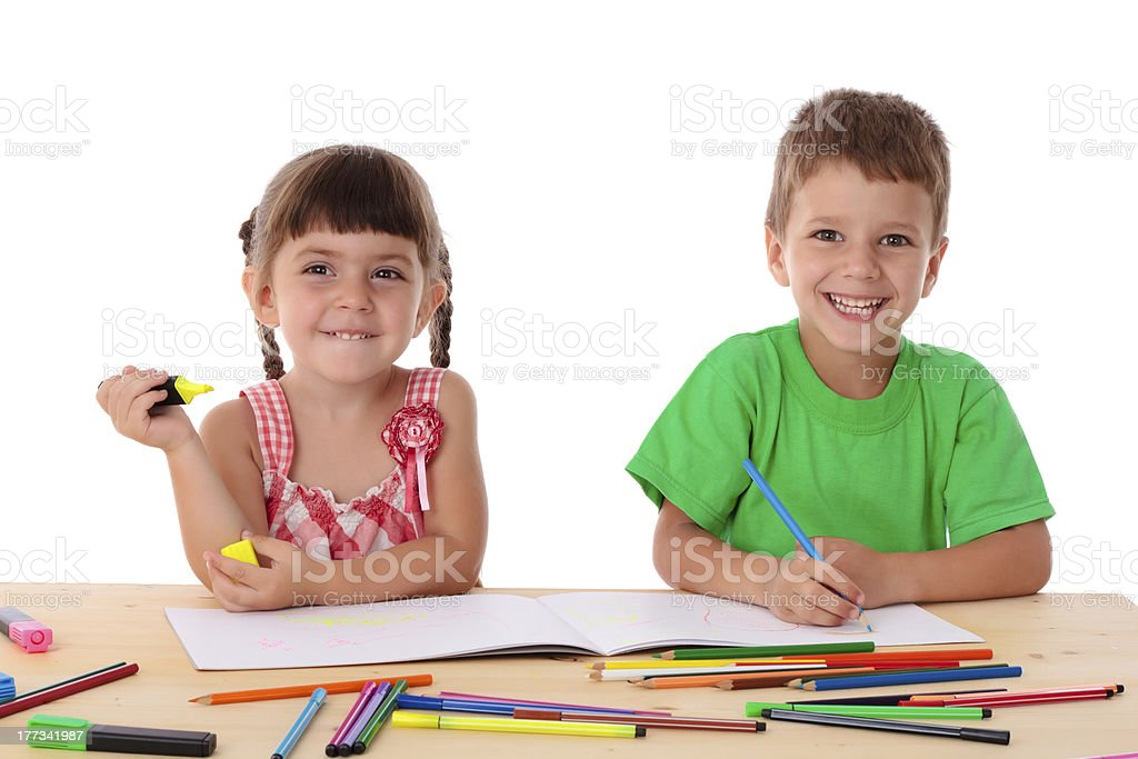 Two little kids draw with crayons royalty-free stock photo