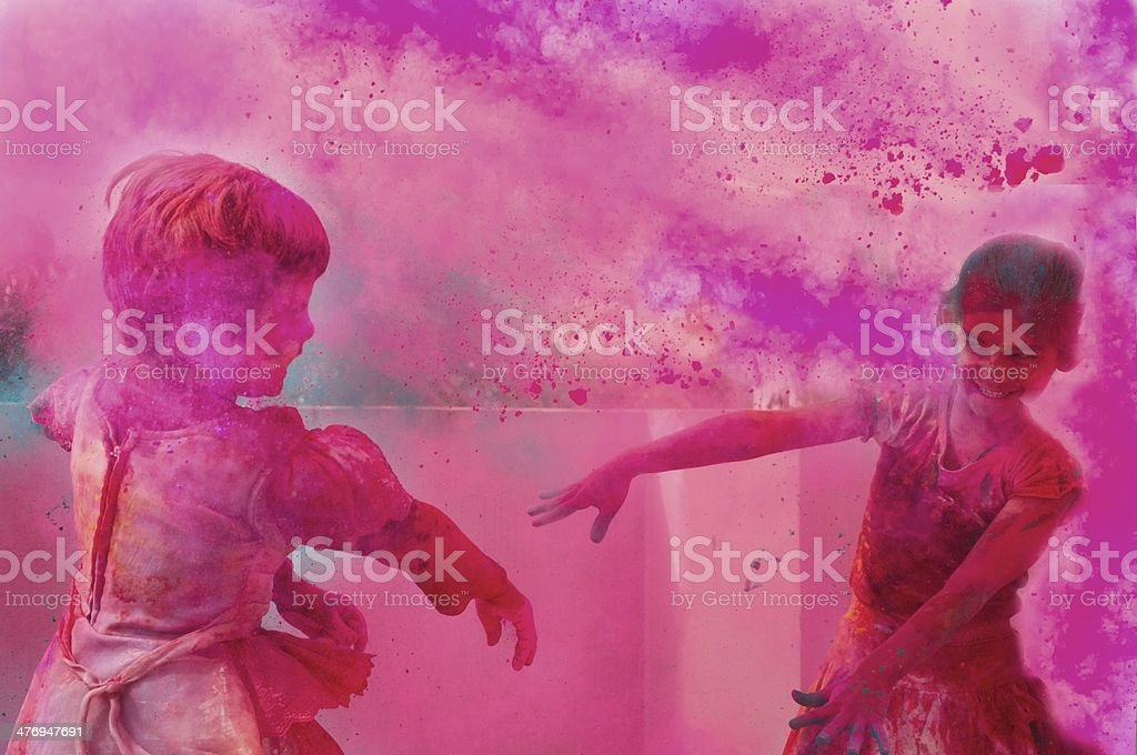 Two little kids playing with gulal on holi. stock photo