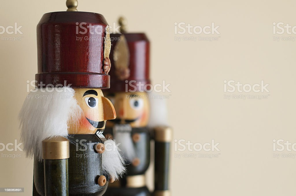 Two little nutcrackers made of wood with white hairs stock photo