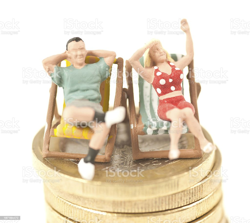 two little people in desk chairs on euro coin royalty-free stock photo