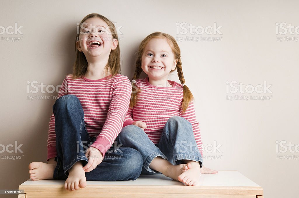Two Little Sisters Laughing Together royalty-free stock photo