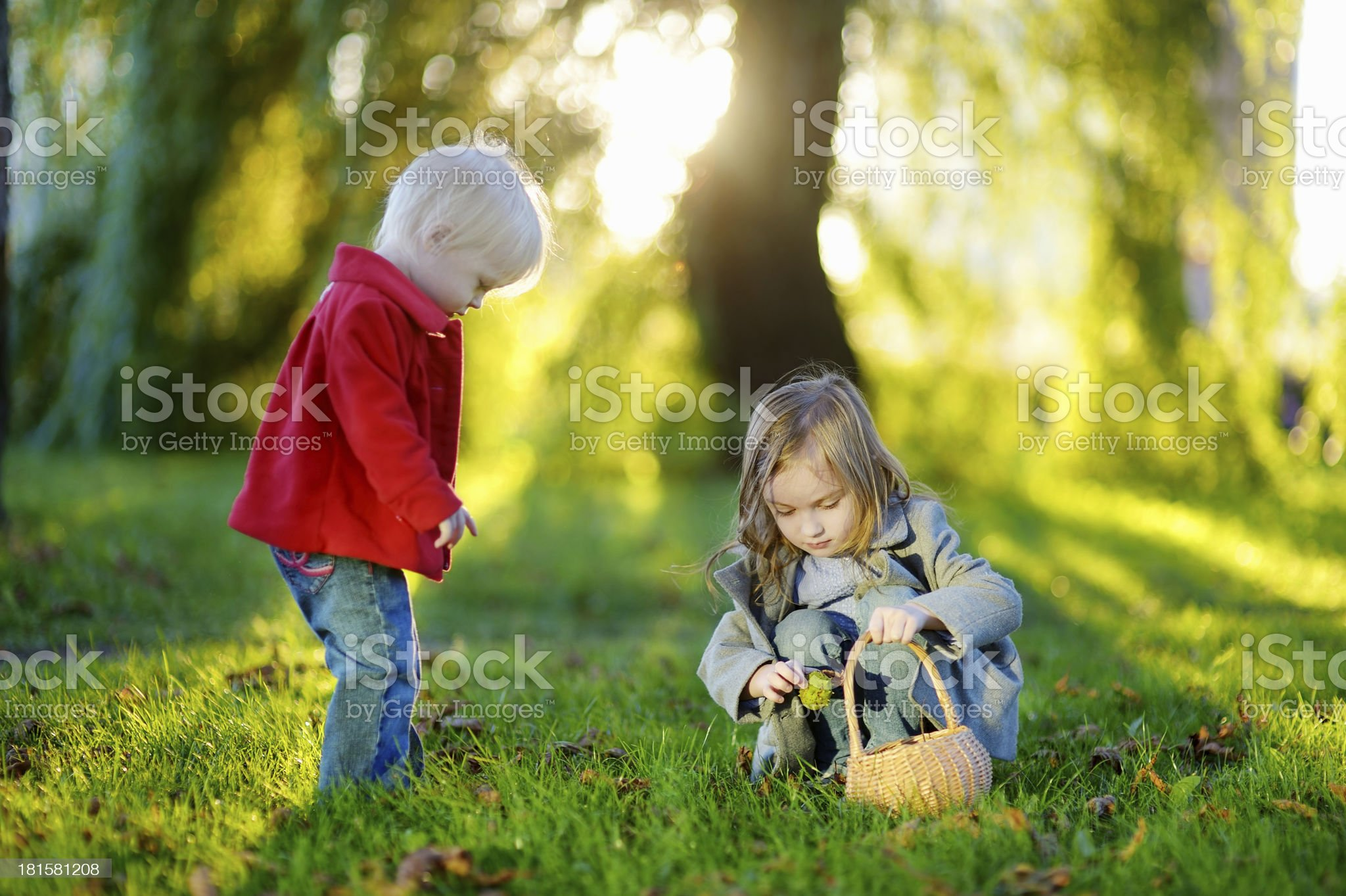 Two little sisters playing outside royalty-free stock photo