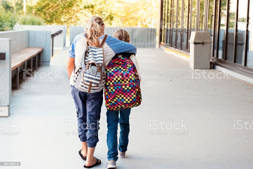 Two littles girls at school stock photo