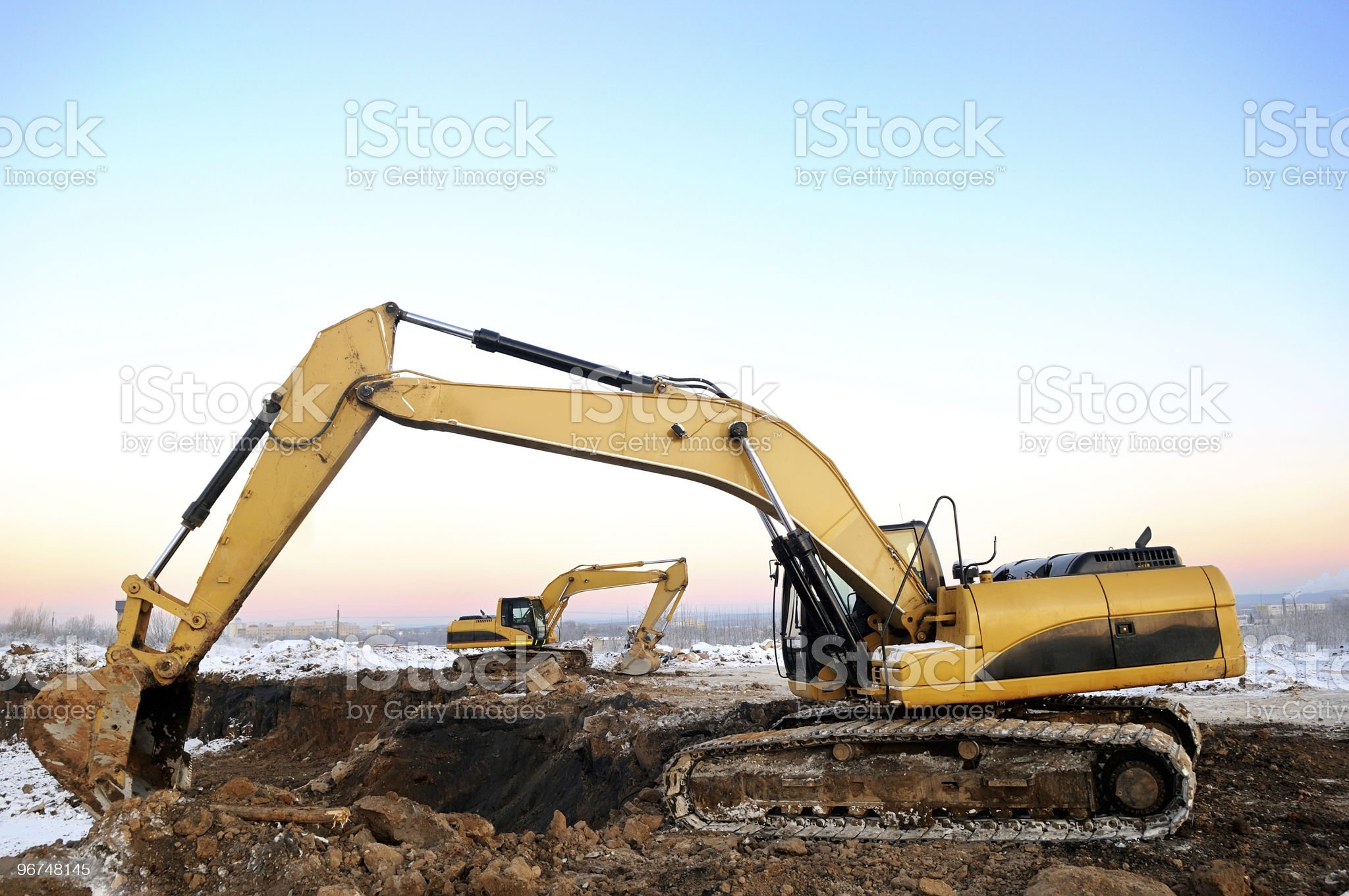 two loader excavators at open cast in winter royalty-free stock photo