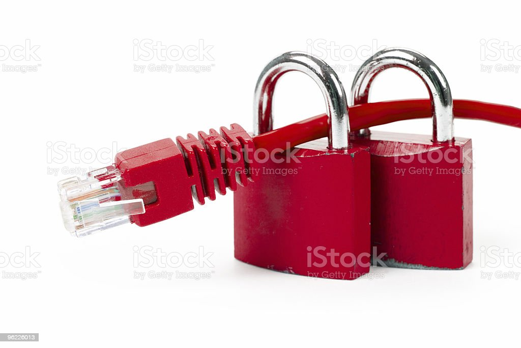 Two locks with that cable running through  royalty-free stock photo