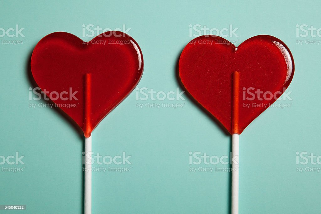 Two lollipops. Red hearts. Candy. Love concept. Valentine day. stock photo