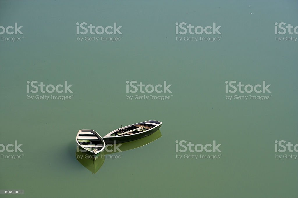 Two lonely boats royalty-free stock photo